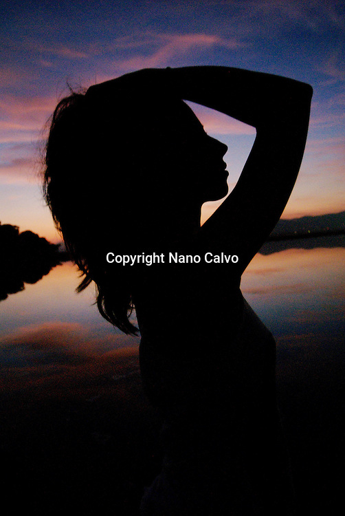 MR Silhouette of an attractive young woman at sunset