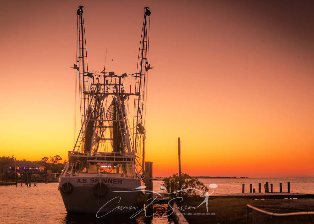 The sun sets on the A.S. Skinner shrimp boat, docked in Dauphin Island, Alabama. (Photo by Carmen K. Sisson/Cloudybright)