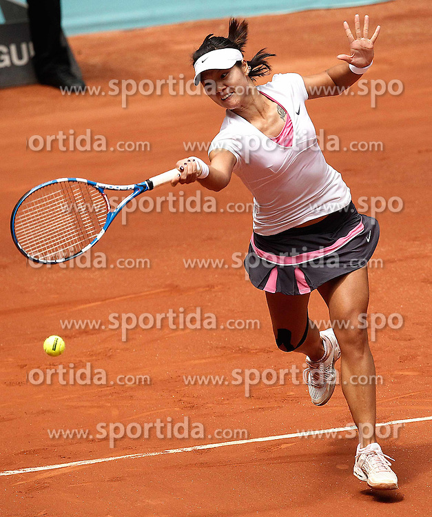 05.05.2011, Marid, ESP, WTA Tour, Mutua Madrid Open, im Bild Chine's Na Li during  Mutua Madrid Tennis Open on May 5, 2011, EXPA Pictures © 2011, PhotoCredit: EXPA/ Alterphotos/ Cesar Cebolla / ALFAQUI