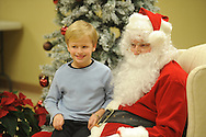 Hudson Clark visits with Santa Claus during Family Crisis Services' Milk and Cookies with Santa in Oxford, Miss. on Thursday, December 5, 2013. Addy Photography provided photography of the event.
