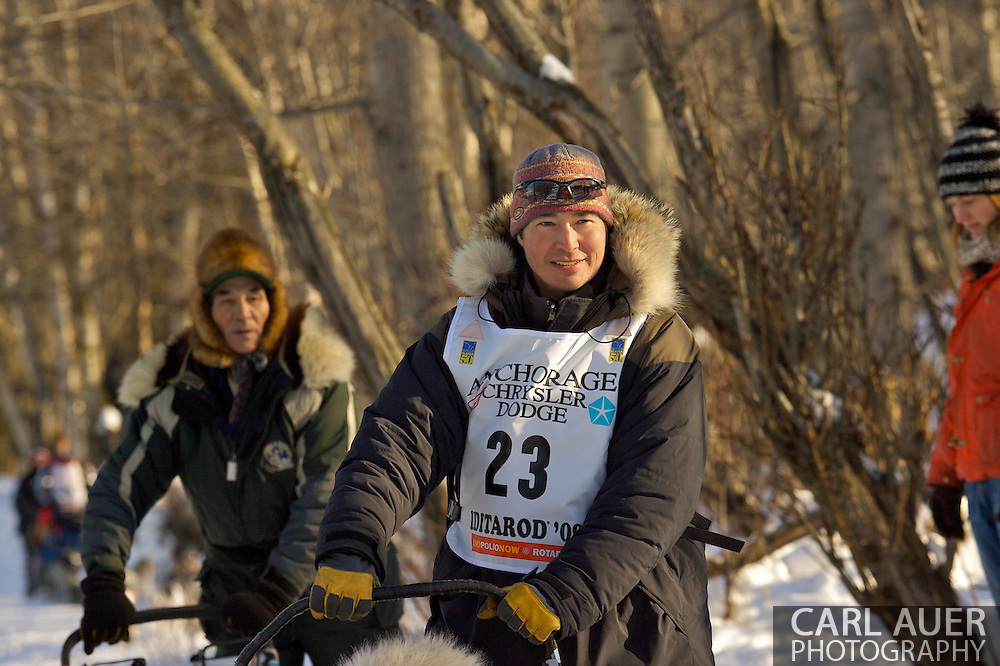 March 7th, 2009:  Anchorage, Alaska - Robert Nelson of Kotzebue, Alaska moves quickly through the woods of the Behm Lake shoreline during the Ceremonial Start of the 2009 Iditarod.