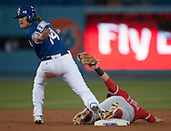 The Angels' Johnny Giavotella shows the ball in his glove as the Dodgers' Enrique Hernandez tries to signal safe during the Angels' Freeway Series game against the Dodgers Thursday night at Dodger Stadium.<br /> <br /> ///ADDITIONAL INFO:   <br /> <br /> freeway.0401.kjs  ---  Photo by KEVIN SULLIVAN / Orange County Register  --  3/31/16<br /> <br /> The Los Angeles Angels take on the Los Angeles Dodgers at Dodger Stadium during the Freeway Series Thursday.<br /> <br /> <br />  3/31/16
