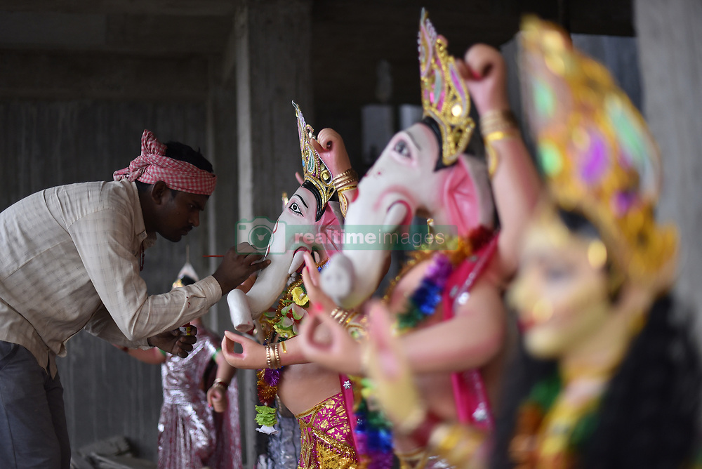 October 9, 2018 - Lalitpur, NP, Nepal - 27yrs old Nepalese artist, ARUN PANDIT paints on clay idol of the Hindu God Ganesh, which is being transported to worship in different parts of Kathmandu Valley on Tuesday, October 09, 2018 at Lalitpur, Nepal. Dashain is the most auspicious and biggest celebrated festival in Nepal offering devotion towards Goddess Durga, who symbolizes power and the triumph of good over evil in Hindu mythology. Dashain is a 10-day grand festival of Nepalese Hindu people. (Credit Image: © Narayan Maharjan/NurPhoto via ZUMA Press)