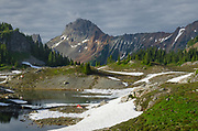 Backcountry campsite. Yellow Aster Butte Basin, Mount Baker Wilderness. American Border Peak is in the distance. North Cascades Washington