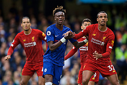 LONDON, ENGLAND - Sunday, September 22, 2019: Chelsea's Tammy Abraham (L) and Liverpool's Joel Matip during the FA Premier League match between Chelsea FC and Liverpool FC at Stamford Bridge. (Pic by David Rawcliffe/Propaganda)