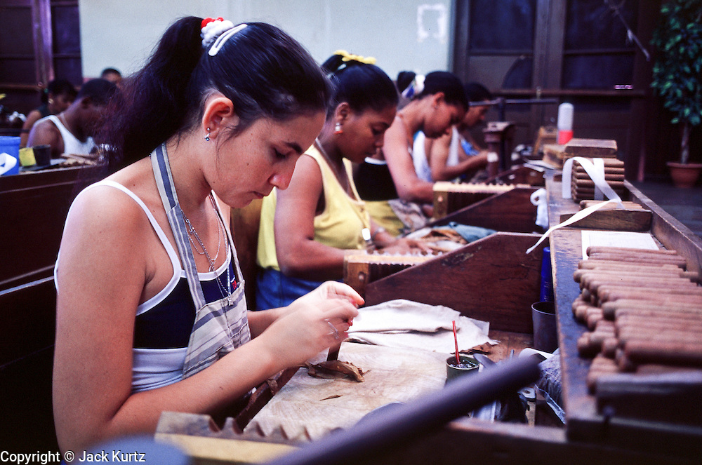 HAVANA, CUBA: Rolling cigars in the Partagas Cigar Factory in Havana, Cuba. Wealthy people prize Cuban cigars as the symbol of a fine smoke and revolutionaries favor them because of the cigar?s traditional tie to Fidel Castro.  Photo By Jack Kurtz