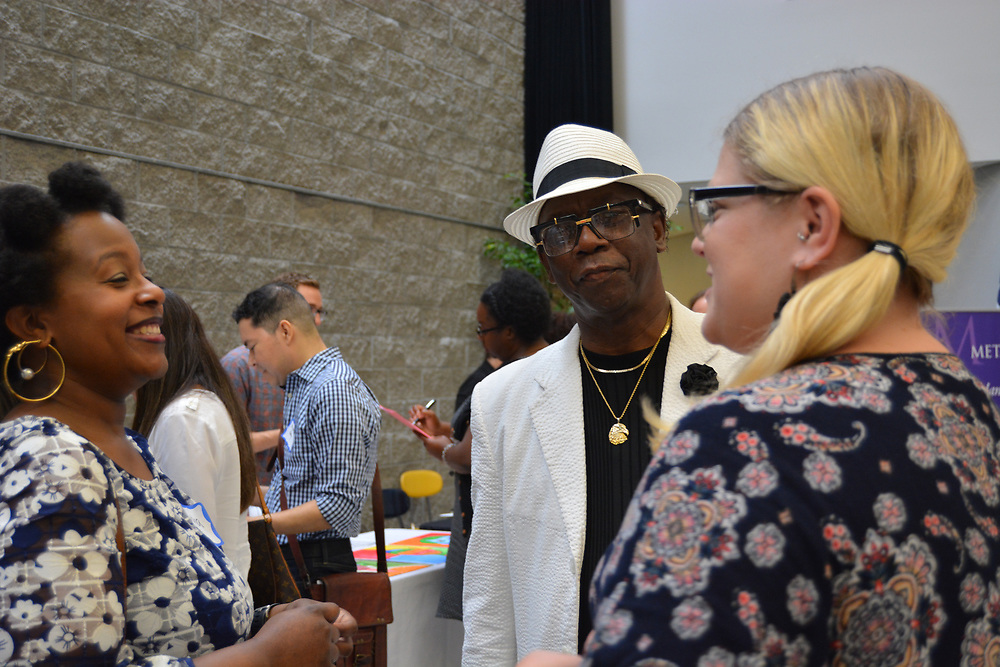 Arts Access Initiative Meet & Greet at HSPVA, where school representatives get a chance to talk to partnering arts organizations. Atherton ES Principal Albert Lemons chats with other AAI reps at the event.