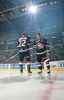 KELOWNA, CANADA - OCTOBER 18:  MacKenzie Johnston #22 and Filip Vasko #10 of the Kelowna Rockets take part in a pre-game ritual on the ice as the Prince George Cougars visit the Kelowna Rockets on October 18, 2012 at Prospera Place in Kelowna, British Columbia, Canada (Photo by Marissa Baecker/Shoot the Breeze) *** Local Caption ***