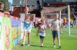 The sons of the late Adam Stansfield parade around the pitch with an Exeter 5 pound note to mark the 5 year anniversary since his passing. Stansfield had played for Yeovil Town and Exeter City during his playing career as the 2 sides met on the opening day of the season. - Photo mandatory by-line: Harry Trump/JMP - Mobile: 07966 386802 - 08/08/15 - SPORT - FOOTBALL - Sky Bet League Two - Exeter City v Yeovil Town - St James Park, Exeter, England.