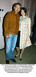 Club owner PIERS ADAM and MISS SOPHIE VANACORE at a party in London on 11th May 2004.PTZ 40