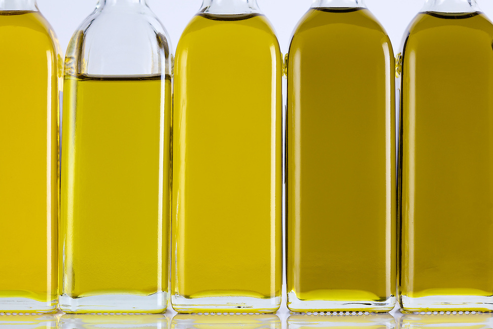 Olive Oil Bottles in a Row and Different Shades