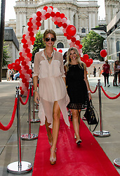 © Licensed to London News Pictures. 19/08/2012. London,UK.  Millie Mackintosh, of reality TV show Made in Chelsea, participating in exclusive fundraising walk The Sunday Strut, in aid of The Princes Trust.  Here she crosses the finish line with TV Presenter and Princes Trust Ambassador Anna Williamson. Photo credit : Richard Isaac/LNP