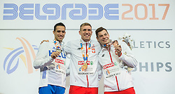 Second placed Konstadínos Filippídis of Greece, Winner Piotr Lisek of Poland and third placed Paweł Wojciechowski of Poland celebrate during victory ceremony after competing in the Pole Vault Men Final on day two of the 2017 European Athletics Indoor Championships at the Kombank Arena on March 4, 2017 in Belgrade, Serbia. Photo by Vid Ponikvar / Sportida