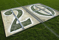 A stencil used to paint the twenty yard line on a football field.