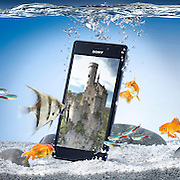 Mobile phone in a fish tank of with fish and bubbles Ray Massey is an established, award winning, UK professional  photographer, shooting creative advertising and editorial images from his stunning studio in a converted church in Camden Town, London NW1. Ray Massey specialises in drinks and liquids, still life and hands, product, gymnastics, special effects (sfx) and location photography. He is particularly known for dynamic high speed action shots of pours, bubbles, splashes and explosions in beers, champagnes, sodas, cocktails and beverages of all descriptions, as well as perfumes, paint, ink, water – even ice! Ray Massey works throughout the world with advertising agencies, designers, design groups, PR companies and directly with clients. He regularly manages the entire creative process, including post-production composition, manipulation and retouching, working with his team of retouchers to produce final images ready for publication.