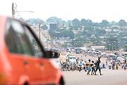 Boys walk across a street in Bouake, Cote d'Ivoire on Sunday July 14, 2013.