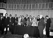 "27/05/1959<br /> 05/27/1959<br /> 27 May 1959<br /> Presentation of Esso Perpetual Trophy to the Listowel Drama Group at the Shelbourne Hotel, Dublin. The trophy and replicas for the  All Ireland Amateur Dram festival were presented by Mr. T.F. Laurie, Chairman and Managing Director of Esso Petroleum Co. (Ireland) Ltd. at a special luncheon. The Listowel group won the competition with their performance of the 3 Act play ""Sive"" by John B. Keane. Picture shows Mr Bryan McMahon (2nd from left), President of the Listowel Drama Group replying to Mr. T.F. Laurie (2nd from right), after the presentation. In the rear of the photo with their replica trophies are (l-r): Brendan Carroll (Producer); John B. Keane (author of ""Sive""); John Flaherty; Hilery Neilson; Brian Brennan; Kevin O'Donovan; William Kearney; Siobhan Cahill; Nora Relihan; Margaret Dillon (behind Mr. Laurie) and Sean Cahill."
