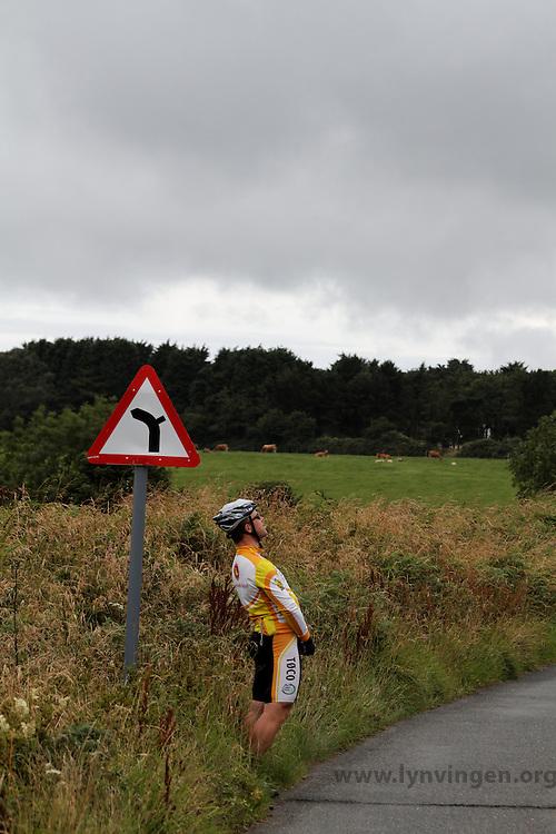 biker peeing roadside..