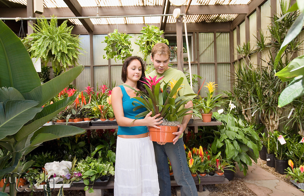 Couple Choosing Plant in Greenhouse