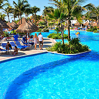 Couple Holding Hands Along Pool at Riviera Maya, Mexico<br />