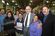 Warren Buffett with his new family from Benjamin Moore Paints at the Clifton, N.J. distribution center during his first visit to Benjamin Moore on Tues May 8, 2001. Buffett's Berkshire Hathaway officially became Benjamin Moore's owner on January 1,2001.  Contact Jocelyn Kalsmith 212-885-0443. (photo by Gabe Palacio/ImageDirect)