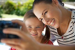Woman and Young Girl Taking Photo of Themselsves