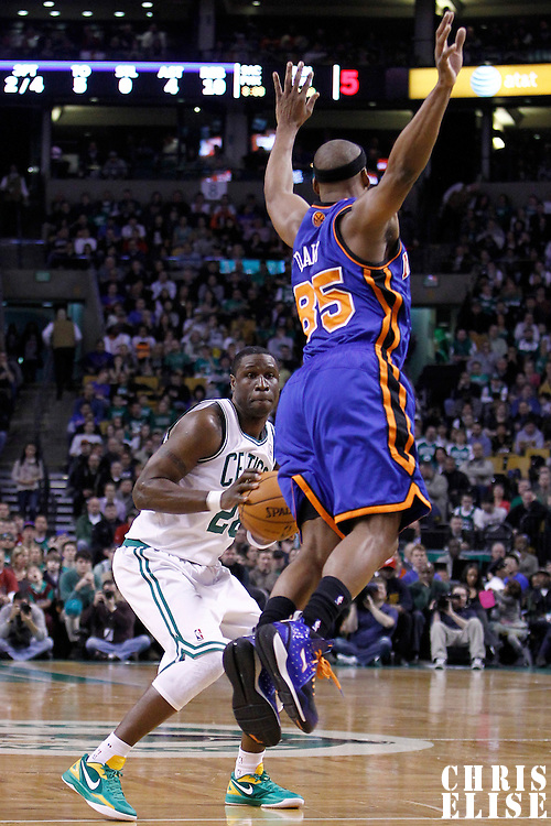 04 March 2012: New York Knicks point guard Baron Davis (85) jumps past Boston Celtics small forward Mickael Pietrus (28) during the first half of Boston Celtics vs the New York Knicks at the TD Garden, Boston, Massachusetts, USA.