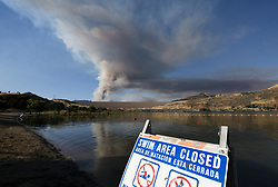 June 17, 2017 - Los Angeles, California, United States - A ''No Swimming'' sign at Castaic Lake where a one thousand-acre fire rages behind it. Castaic, California on June 17, 2017. Firefighters battle several wildfires in Southern California as the region is hit with the first major heat wave of the summer. (Credit Image: © Ronen Tivony/NurPhoto via ZUMA Press)