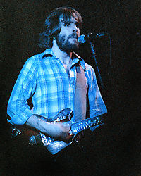 Bob Weir performing with The Grateful Dead. Live in Concert at The Springfield Civic Center on 23 April 1977. Solo Shot in Bright Blue Light.