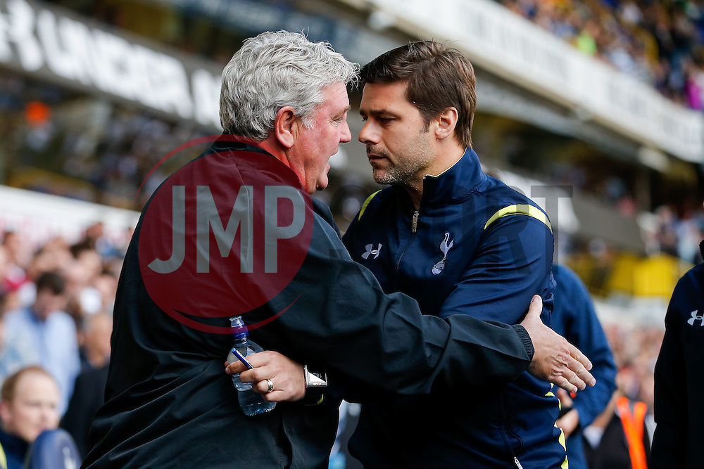 Hull City Manager Steve Bruce is greeted by Tottenham Hotspur Manager Mauricio Pochettino - Photo mandatory by-line: Rogan Thomson/JMP - 07966 386802 - 16/05/2015 - SPORT - FOOTBALL - London, England - White Hart Lane - Tottenham Hotspur v Hull City - Barclays Premier League.