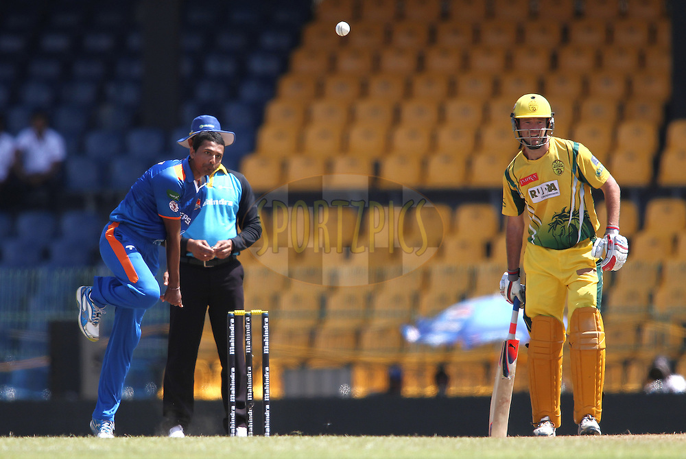 Suraj Randiv of Nagenahira Nagas sends down a delivery during match 19 of the Sri Lankan Premier League between Uthura Rudras and Nagenahiras held at the Premadasa Stadium in Colombo, Sri Lanka on the 26th August 2012. .Photo by Shaun Roy/SPORTZPICS/SLPL