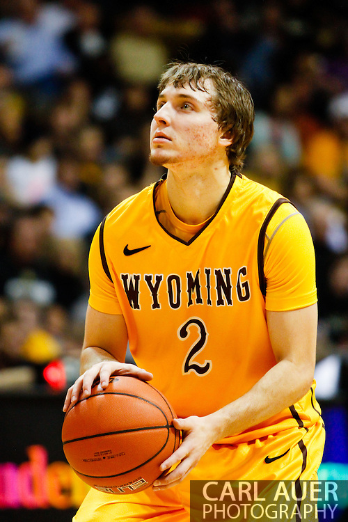 November 13th, 2013:  University of Wyoming Cowboys junior guard Riley Grabau (2) shoots a technical foul in the first half of action in the NCAA Basketball game between the University of Wyoming Cowboys and the University of Colorado Buffaloes at the Coors Events Center in Boulder, Colorado