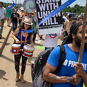 Activists march across the Robert E Lee bridge in protest of the ACP and Union Hill compressor station in Richmond, Va., May 17, 2019. (Photo by Parker Michels-Boyce)