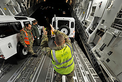 © Licensed to London News Pictures. 15 Nov 2013. RAF Brize Norton. An RAF C17 Aircraft packed with 3 x JCB's, 2 x Land Rover Defenders and 2 pallets of spares sent on the first Typhoon relief aid flight to depart from the UK. . Photo credit : MarkHemsworth/LNP