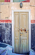 Oia, Santorini Island, Greece: locked yellow door, red striped wall