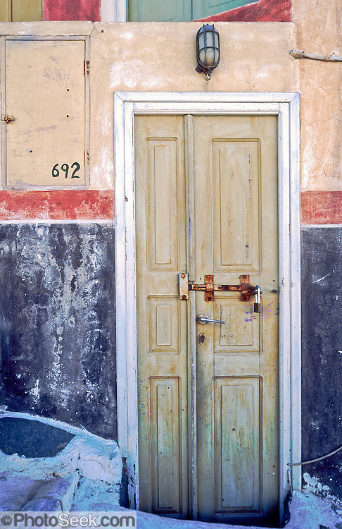 Oia, Santorini Island, Greece: locked yellow door, red striped wall