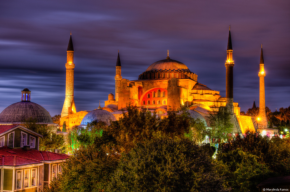 Aya Sofya at night rendered in high dynamic range with vibrant colors under overcast skies during the blue hour.