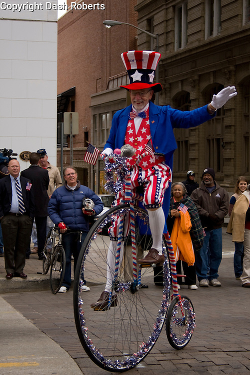 Uncle Sam pedals down Gay Street in the 2008 Veteran's Day Parade in downtown Knoxville, Tennessee