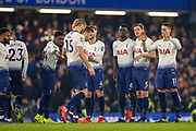 Tottenham players commiserate with Tottenham Hotspur midfielder Eric Dier (15) who missed his penalty during the EFL Cup semi final second leg match between Chelsea and Tottenham Hotspur at Stamford Bridge, London, England on 24 January 2019.