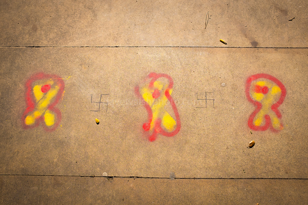 Extreme right graffiti in Sant Cugat del Valles, Catalonia, Spain. The original yellow ribbon graffiti symbolises solidarity for Catalan political prisoners - the red additions and swastikas are apparently added by ultradreta - far right nationalists who want Catalonia to remain in Spain.
