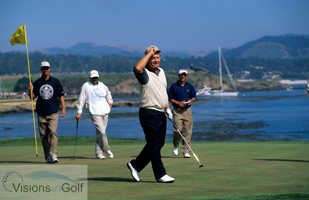June 2000. Pebble Beach Golf Links, California, USA. Jack Nicklaus waves to the gallery as he walks off the green on the 18th in his final US Open.<br />