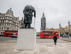 © Licensed to London News Pictures. 09/11/2017. London, UK. The statue of Winston Churchill stands in Parliament Square as Big Ben chimes at 9am. The bell has been silenced since August 21 during repairs to the Elizabeth Tower. Palace of Westminster clockmakers will work through the day adjusting the bells to ensure that they strike at exactly the right time for Armistice Day commemorations at the 11th hour of November 11, followed by Remembrance Sunday events the following day. Photo credit: Rob Pinney/LNP