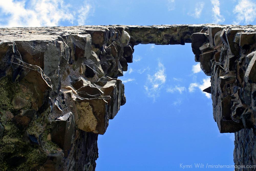 Europe, Ireland, Northern Ireland, Bushmills. Dunluce Castle arch and sky.