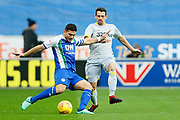 Wigan Athletic midfielder Sam Morsy (5) under pressure from /d4 during the EFL Sky Bet Championship match between Wigan Athletic and Derby County at the DW Stadium, Wigan, England on 8 December 2018.
