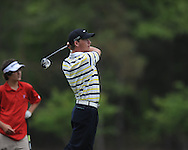 Oxford High's Turner Arnold hits a tee shot on the 8th hole during the opening round of the MHSAA Class 5A state championship golf tournament at the Ole Miss Golf Course in Oxford, Miss. on Wednesday, May 1, 2013.