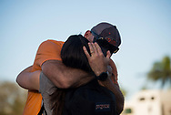 A father embraces his daughter Wednesday, Feb. 14, 2018, at University Drive and Holmberg Road, where students reunited with family members after a mass shooting at Marjory Stoneman Douglas High School in Parkland. (XAVIER MASCAREÑAS/TREASURE COAST NEWSPAPERS)