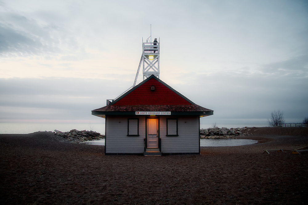 The Leuty Lifesaving Station, early dawn. Since it was built in 1920 by Chapman and Oxley architects, the Leuty Lifeguard Station has helped to save thousands of lives. Over the years it has been moved four times to keep it close to Lake Ontario's edge. During the 1980's the Leuty had fallen into disrepair and was threatened with demolition. Local residents formed S.O.S. (Save Our Station), and enough money was raised to restore the structure. It has since been declared an important historic site by the Toronto (Canada) Historical Board.<br />