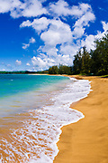 Empty beach and blue Pacific waters on Hanalei Bay, Island of Kauai, Hawaii
