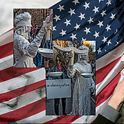 Woman dressed in all white as &quot;Blind or Lady Justice&quot; at rally in the park.<br /> <br /> Women took to the streets of Manhattan Wednesday, March 8, 2017, in a show of solidarity with International Women's Day and the A Day Without a Woman strike and to voice their anger again at President Trump.<br /> <br /> New Yorkers both men and women attended rally at Washington Square Park holding signs in protest against President Trump.