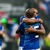 05 September 2009: French forward and captain Thierry Henry is congratulated by French defender William Gallas after scoring during the World Cup 2010 qualifying football match France vs. Romania (1-1), on September 5, 2009 at the Stade de France stadium in Saint-Denis, near Paris, France.